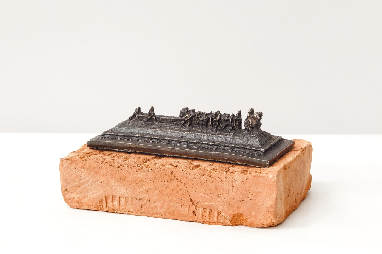 "Jaime Lauriano, ""Monumento às Bandeiras,"" 2016, cast in brass and melted cartridges of ammunition used by the Military Police and Brazilian Armed Forces, set on a red brick base; a scale replica of Victor Brecheret's granite ""Monumento às Bandeiras"" (1921–54), which stands in Ibirapuera Park, São Paulo."
